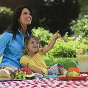Mother and daughter picnicking
